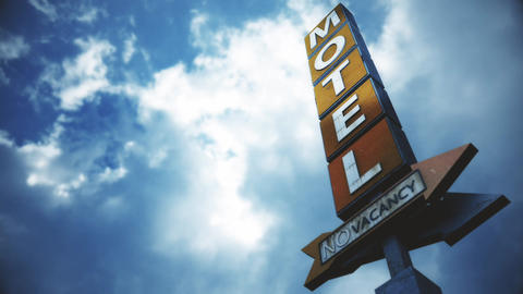 4K Old Grungy Motel Sign under Daytime Cloudy Sky Timelapse 5 Animation