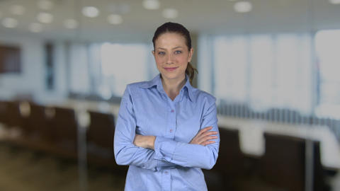 Female business person with flirtatious look in an office Footage