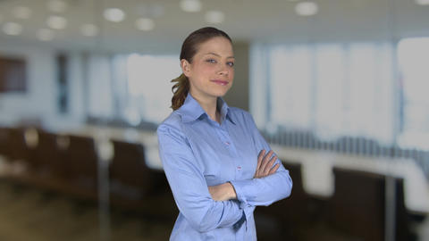 Happy arms crossed working female professional in an office Footage