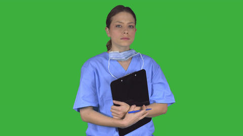 A determined medical professional turns to the viewer (Green Key) Live Action