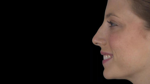 Profile of a smiling natural female (Transparent Background) Footage