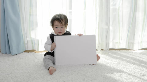 Child with skechbook with smile Footage