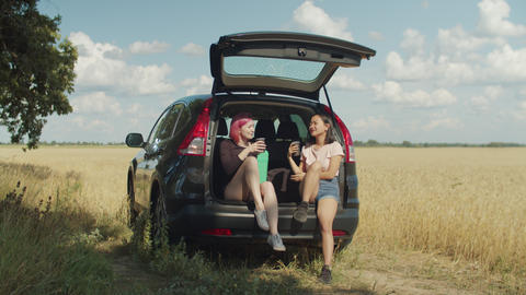 Charming women having coffee break during road trip Live Action