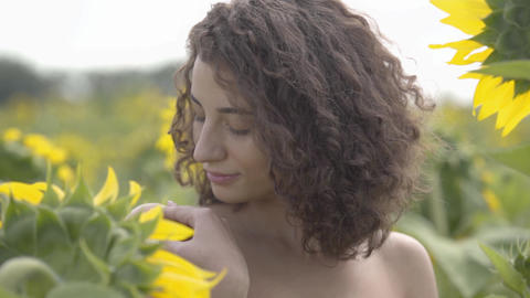 Portrait of lovely fun curly playful sensual woman looking at the camera smiling Live Action