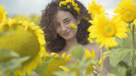 Portrait of cute fun curly playful sensual woman looking at the camera smiling Live Action