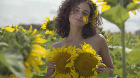 Portrait of cute curly playful girl looking at the camera…, Live Action