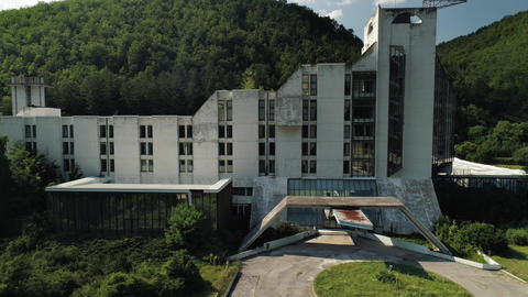 Hotel and spa - abandoned. Modernistic architecture. Aerial drone shot parallel Live Action