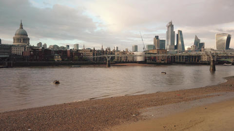 View to Millennium Bridge and Saint Paul's Cathedral from Thames embankment ビデオ