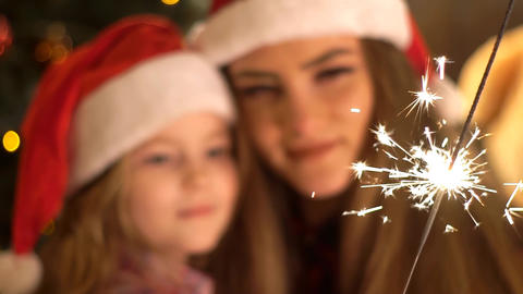 Girls Family With Christmas Hat And Two Sparklers Happy Emotion Live Action