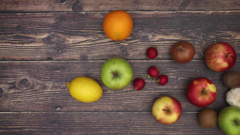 Fruits falling on right side of wooden background - Stop motion Animation
