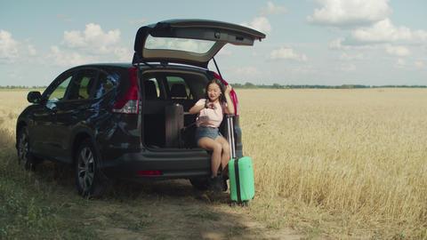 Impatient asian woman waits for friend for car trip Footage