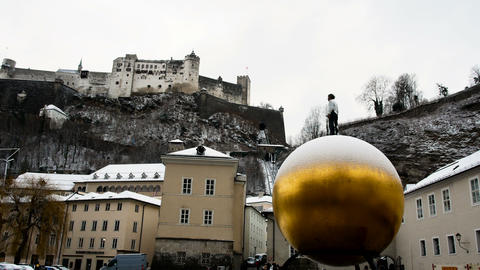 golden sphere in the main square of Salzburg in the winter time Live Action