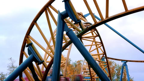 1080p Roller Coaster in Amusement Park Rides Against Sky Footage