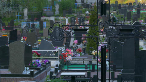 4K Ungraded: Holy Cross, Tombstones and Graves With Flowers in Peaceful Quiet Footage
