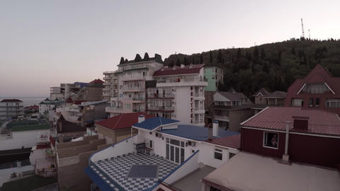 Hotels on the Black Sea in Crimea. The drone flew over the restaurant. Evening ビデオ