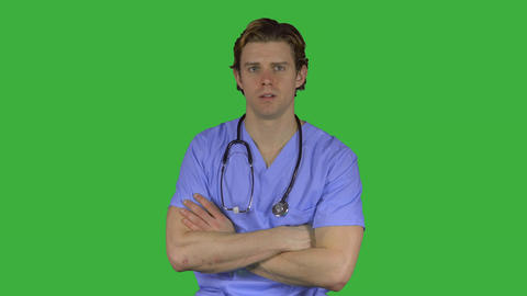 Stressed man in medical clothing (Green Key) Footage