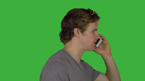 Side view of man talking on phone (Green Key) Footage