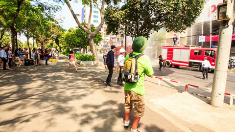 Tourist in Hat Crowd Watch Fire Brigade Working with Water Hoses Footage