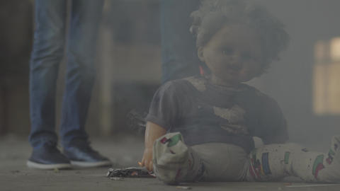 Two unrecognized boys in the dark room in the cloud of smoke. Scary dirty doll Footage