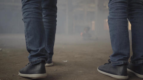 Feet of two boys running through abandoned building in the cloud of smoke. Scary Live Action