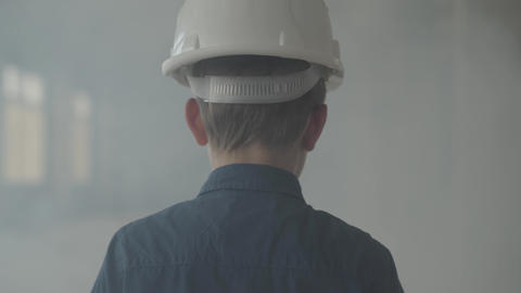 Portrait adorable boy in a protective helmet turning and looking at the camera Live Action