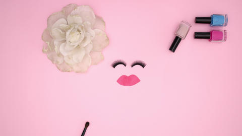 Woman's accessories and make up products appear on pink background - Stop motion Animation