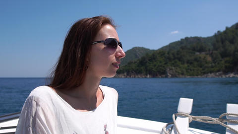 A woman in glasses admires a beautiful view of the islands from a beautiful boat Footage