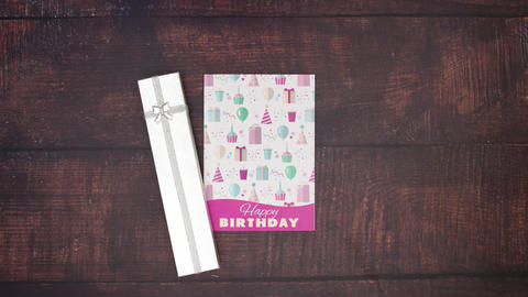 Beautiful birthday card and presents appear on wooden background - Stop motion Animation