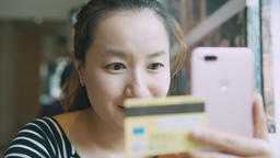 Woman Online Banking Using Smartphone Shopping Online With Credit Card Live Action