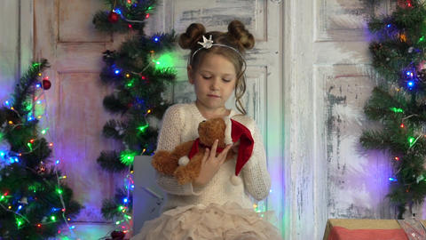 Child Playing With Teddy Bear Toy As Present, Girl By A Christmas Tree, Child Live Action