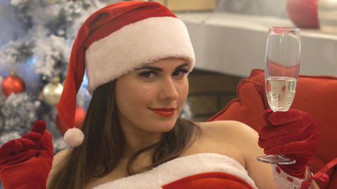 Beautiful Girl Santa Claus Drinking Champagne And Smiling. She Is Very Beauti Live Action