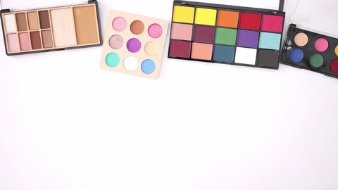 Four eye shadows appear on the top of white background - Stop motion Animation