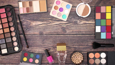 Make up products moving on the edges of wooden background - Stop motion Animation