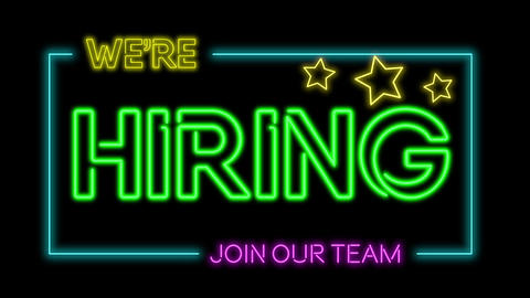 Multicoloured neon sign of the word 'We're hiring - join the team' flickering neon lights on black Animation