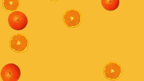 Whole oranges and slices falling against orange background Animation