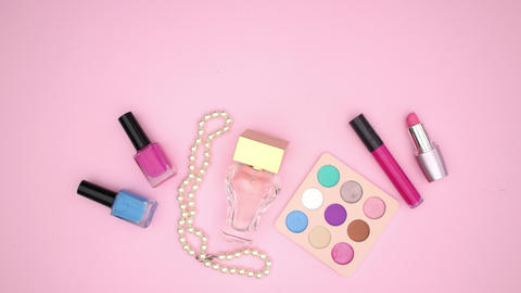 Colorful eye shadow and beauty products moving and appearing on pink background - Stop motion Animation