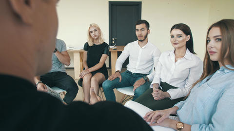 Man sharing troubles with support group Live Action