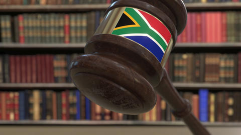 Flag of South Africa on falling judges gavel in court. National justice or Live Action