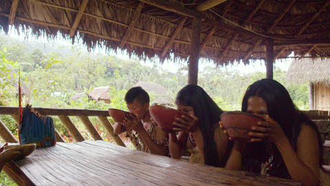 Amazonian Indigenous Family Drinking Fermented Yucca... Stock Video Footage