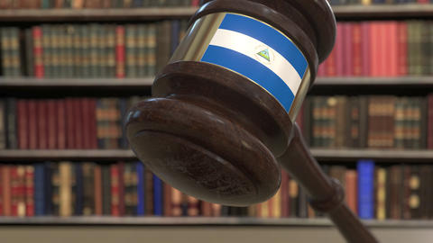 Flag of Nicaragua on falling judges gavel in court. National justice or Live Action