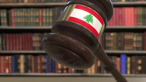 Flag of Lebanon on falling judges gavel in court. National justice or Live Action