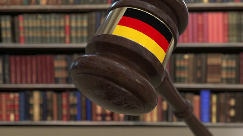 Flag of Gemany on falling judges gavel in court. National justice or Live Action