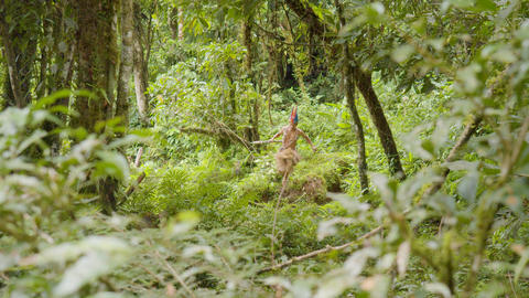 Indigenous Warrior Running Through The Amazon Rainforest In Ecuador Live Action
