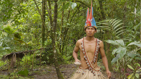 Indigenous Warrior Following The Viewer In The Amazon Jungle In Ecuador Live Action
