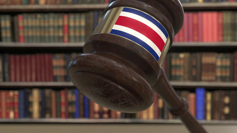 Flag of Costa Rica on falling judges gavel in court. National justice or Live Action