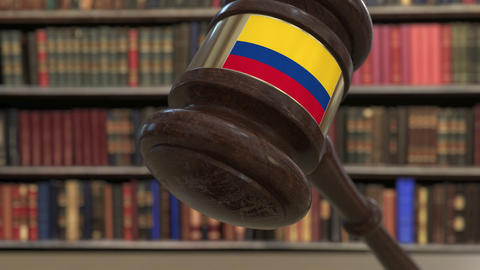 Flag of Colombia on falling judges gavel in court. National justice or Live Action