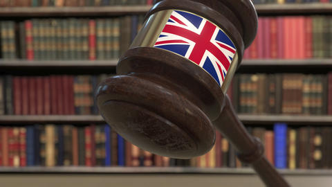 Flag of Great Britain on falling judges gavel in court. National justice or Live Action
