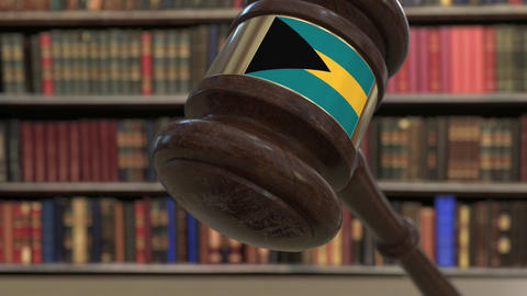 Flag of Bahamas on falling judges gavel in court. National justice or Live Action
