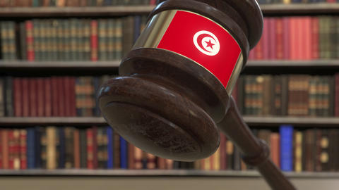 Flag of Tunisia on falling judges gavel in court. National justice or Live Action