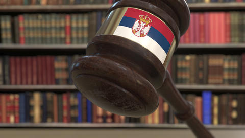 Flag of Serbia on falling judges gavel in court. National justice or Live Action